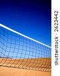 beach volleyball net with sand dunes in the background - stock photo