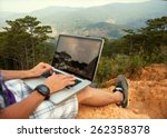 Man With Laptop Sitting On The...