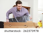 man unpacking new television at ... | Shutterstock . vector #262373978