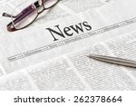 a newspaper with the headline... | Shutterstock . vector #262378664