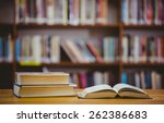 books on desk in library at the ... | Shutterstock . vector #262386683
