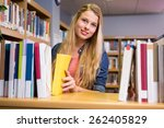 pretty student in the library... | Shutterstock . vector #262405829