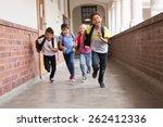 cute pupils running down the... | Shutterstock . vector #262412336