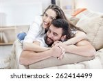 happy couple on bed sofa in...   Shutterstock . vector #262414499