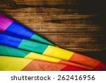 gay pride flag on wooden table... | Shutterstock . vector #262416956
