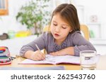 Small photo of Little kid at home doing homework