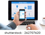 man holding the phone with... | Shutterstock . vector #262707620