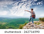 girl standing on a mountain and ...   Shutterstock . vector #262716590