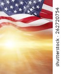 Small photo of American flag and bright sky