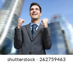 happy businessman obtaining a... | Shutterstock . vector #262759463