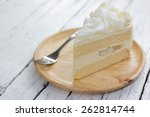 a piece of coconut cake on dish. | Shutterstock . vector #262814744