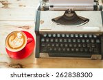 typewriter and red coffee cup... | Shutterstock . vector #262838300