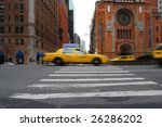 Blurred yellow can on a Manhattan road - stock photo