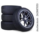 Closeup Of Four Tires With...