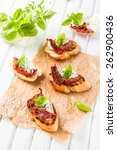 crostini with cheese  basil and ... | Shutterstock . vector #262900436