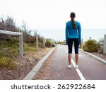 Sporty Young Woman Standing An...