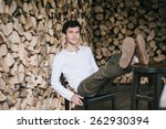 young man leaning on the back... | Shutterstock . vector #262930394