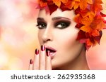 Trendy autumnal makeup and nail art. Fashion beauty model girl. Professional fall fashion makeup and manicure. Closeup portrait over blurred bokeh background with copy space - stock photo