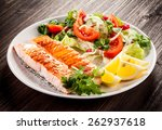 grilled salmon and vegetables | Shutterstock . vector #262937618