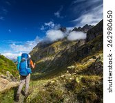 man with backpack hiking in... | Shutterstock . vector #262980650