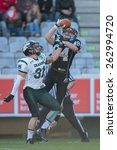 Small photo of INNSBRUCK, AUSTRIA - MARCH 29, 2014: CB Christian Kober (#31 Dragons) and WR Clemens Erlsbacher (#84 Raiders) fight for the ball in an AFL football game.