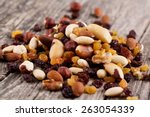 Mixed Nuts On A Plate On Woode...