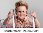 handsome school boy posing with ... | Shutterstock . vector #263063984