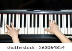 Girl's Hands And Piano Keyboar...