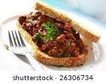 Sandwich of savory ground beef on toasted wholewheat bread.  A delicious variety of a Sloppy Joe. - stock photo