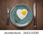 fried egg in shape of heart on...