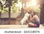 Stock photo women hugging a dog and kiss them playful and happiness 263118074