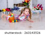 cheerful cute child in a room... | Shutterstock . vector #263143526