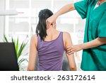 chiropractor adjusting neck... | Shutterstock . vector #263172614