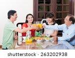vietnamese family having dinner ... | Shutterstock . vector #263202938