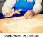 hand of little boy kneading... | Shutterstock . vector #263226038