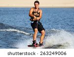 wakeboarder in blackl shorts... | Shutterstock . vector #263249006