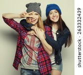 two young girl friends standing ... | Shutterstock . vector #263332439