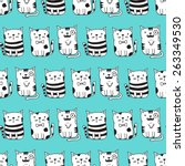 Stock vector cute vector cats seamless pattern cat pattern with light blue background funny doodle wallpaper 263349530