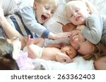 a happy young mother is laying... | Shutterstock . vector #263362403