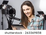 young female photographer... | Shutterstock . vector #263369858