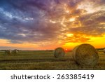 Sunset Over Farm Field With Hay ...