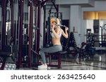 beautiful blonde doing gym... | Shutterstock . vector #263425640
