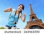 Stock photo happy travel woman in paris with eiffel tower and she show thumb up asian beauty 263463350