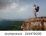 young hiker with backpack... | Shutterstock . vector #263478200