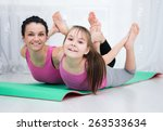 cute mother and daughter doing... | Shutterstock . vector #263533634
