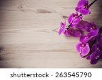 Pink Orchid Flowers On A Woode...