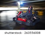 businessman racing in go kart | Shutterstock . vector #263556008
