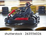 businessman driving go kart | Shutterstock . vector #263556026