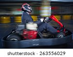 man karting in formalwear | Shutterstock . vector #263556029