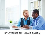 two office workers talking... | Shutterstock . vector #263556059